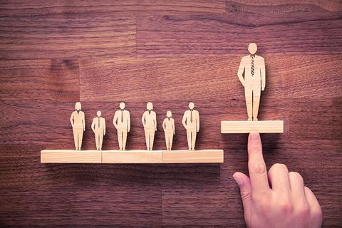 successful leader wood figure