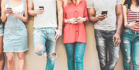 group of people holding smartphones