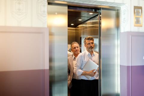 Businessman getting out of elevator