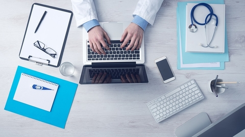 Doctor and digital devices