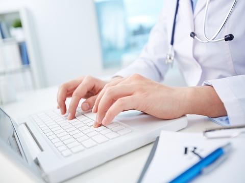 Doctor typing on laptop