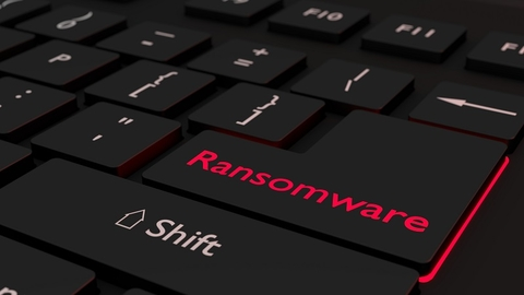 A computer keyboard with the word ransomware highlighted in red