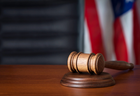 Gavel and flag in courtroom