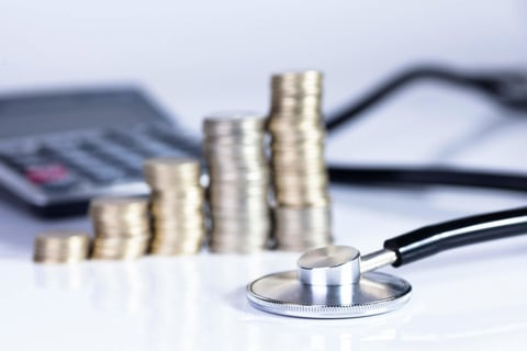 stethoscope, coins and calculator