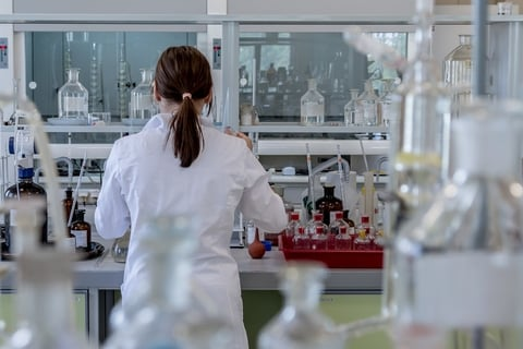 woman with back to camera working in a laboratory