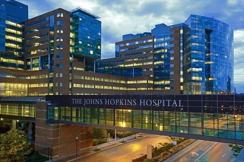 The Johns Hopkins Hospital at night from Orleans Street.