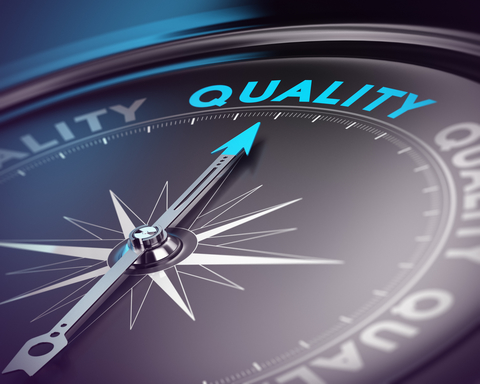 """A compass pointing to the word """"quality."""""""