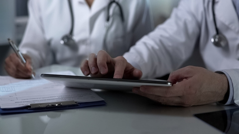 Doctors with a tablet