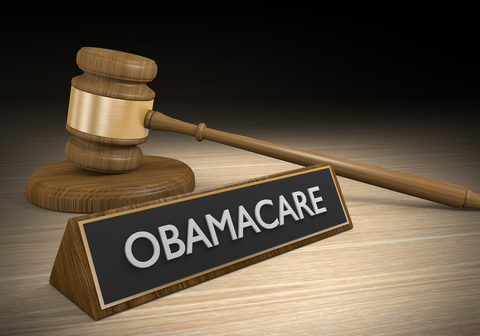 """3D render of a court gavel next to a plaque that says """"Obamacare"""""""