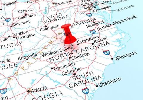 Pushpin showing North Carolina on a map