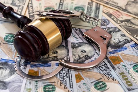 Gavel money handcuffs fraud