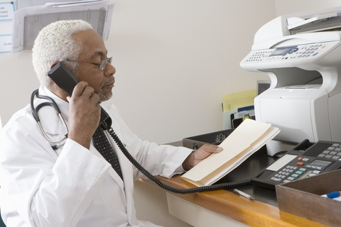Doctor on phone/fax
