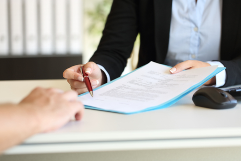 Woman executive offering a contract to be signed