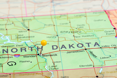A map of North Dakota with a pin in Bismarck