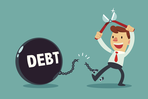 "Illustration of man cutting himself free from a chain attached to a ball that says ""debt"""