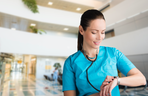 A female doctor is looking at her watch