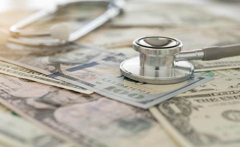 A stethoscope and paper money.