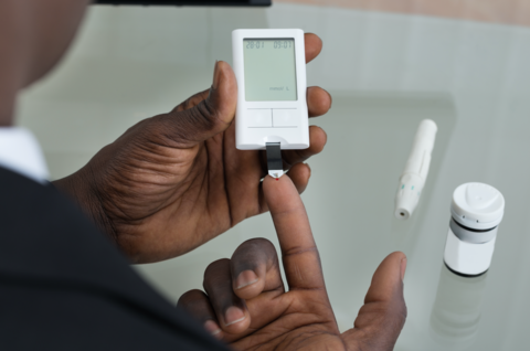 Patient measuring blood glucose
