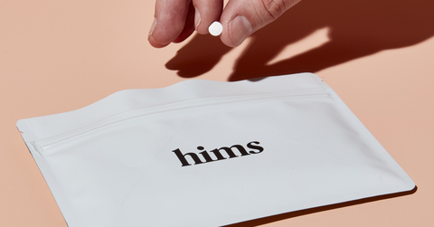 a Hims-branded pouch for medications ordered on the Hims website
