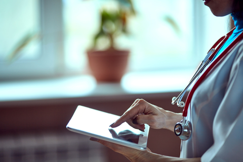 A doctor holding a table