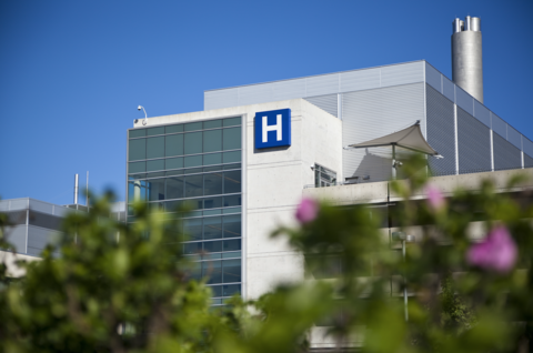 A photo of the exterior of a hospital on a sunny day