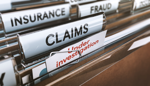 """File folders labeled """"insurance,"""" """"fraud,"""" """"claims,"""" and """"under investigation"""""""