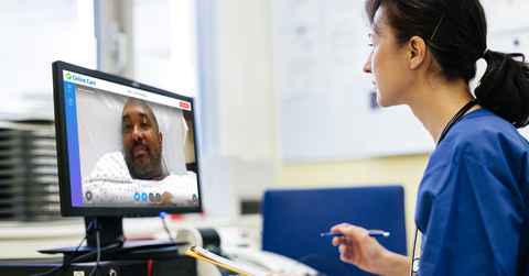 a female behavioral health specialist consults via video with a patient