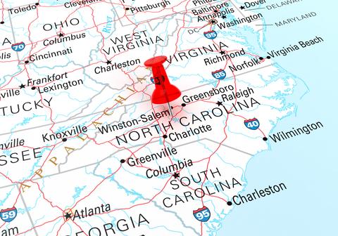 Pushpin showing North Carolina on a map