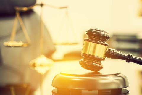 Gavel with scales of justice in background