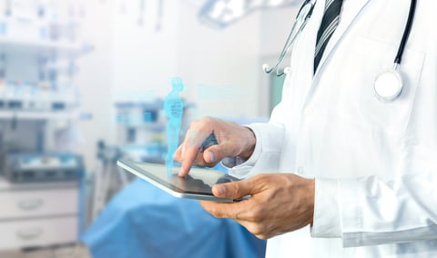 doctor using tablet in operating room