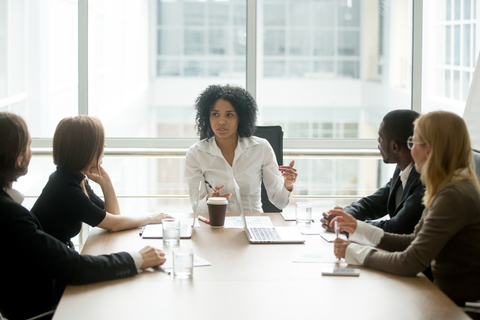 boardroom with woman leading team meeting