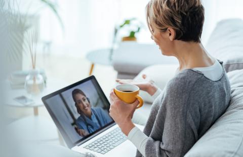 Woman having telehealth visit on her laptop