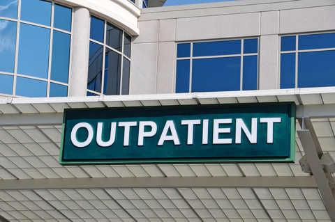 hospital building with a sign that says outpatient