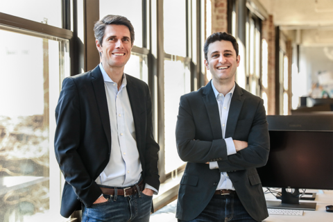 Cedar co-founders Dr. Florian Otto (left) and Arel Lidow stand inside the Cedar office