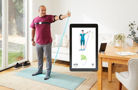 patient performs at-home physical therapy and smartphone screen shows virtual therapy