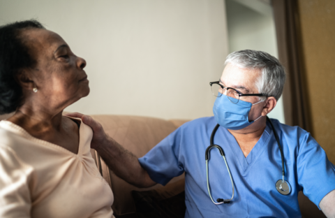A health provider meets with a senior woman