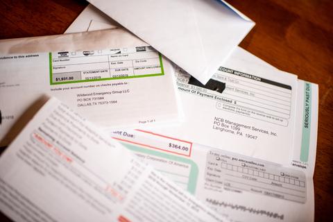 A stack of medical bills