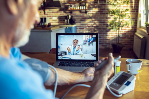 Senior patient consulting with doctor online during telehealth visit