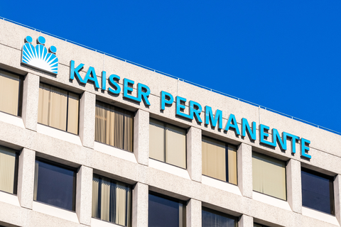 """The side of a building that reads """"Kaiser Permanente"""""""