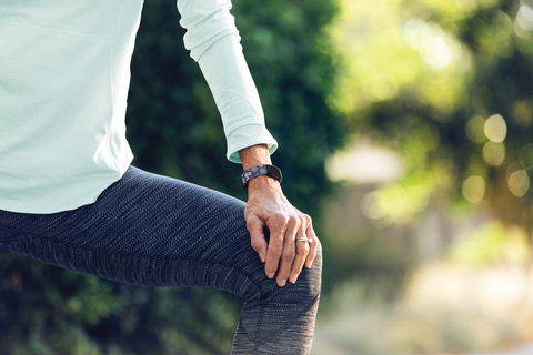 woman exercising wears a Fitbit Inspire 2 device