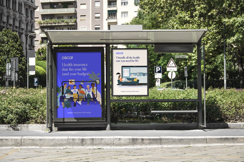 A bus stop displaying advertisements for Oscar Health