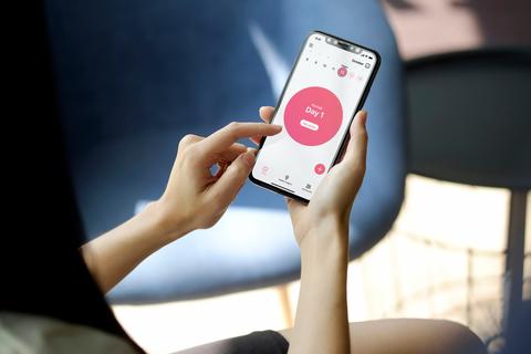 A woman uses the Flo health app