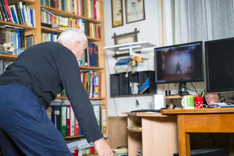 Parkinson Disease patient at home online exercising dancing with help of a physical therapist