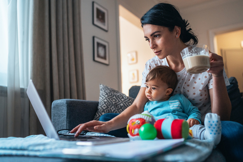 working at home mom using laptop