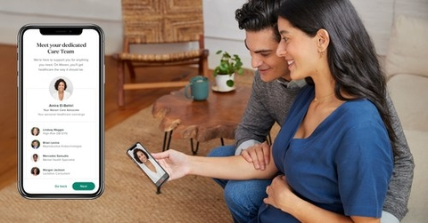 a couple speaks to a doctor virtually using a telehealth app on a smartphone
