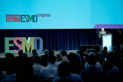 Person speaking onstage at ESMO 2019 in Barcelona