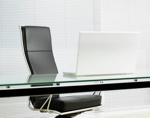Empty desk chair in modern office