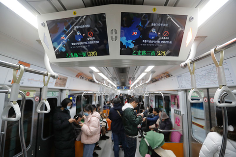 Screens warning about a new coronavirus are seen in a subway train in Seoul, South Korea