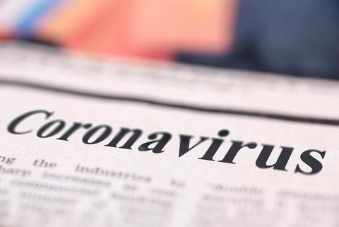 Newspaper with coronavirus headline