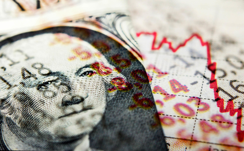 Red stock market line indicating recession and superimposed dollar bill
